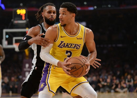 October 22, 2018; Los Angeles, CA, USA; Los Angeles Lakers guard Josh Hart (3) moves the ball against San Antonio Spurs guard Patty Mills (8) during the first half at Staples Center. Mandatory Credit: Gary A. Vasquez-USA TODAY Sports