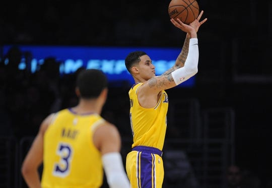 October 22, 2018; Los Angeles, CA, USA; Los Angeles Lakers forward Kyle Kuzma (0) shoots against the San Antonio Spurs during the second half at Staples Center. Mandatory Credit: Gary A. Vasquez-USA TODAY Sports
