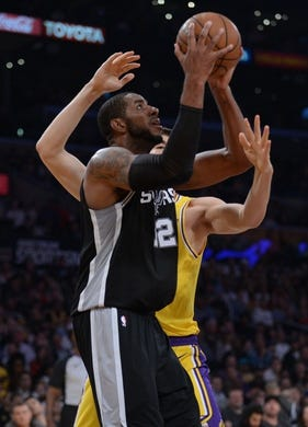 October 22, 2018; Los Angeles, CA, USA; San Antonio Spurs forward LaMarcus Aldridge (12) moves to the basket against the Los Angeles Lakers during the second half at Staples Center. Mandatory Credit: Gary A. Vasquez-USA TODAY Sports
