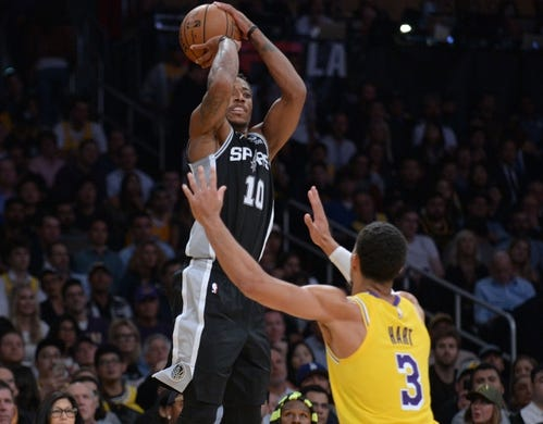 October 22, 2018; Los Angeles, CA, USA; San Antonio Spurs guard DeMar DeRozan (10) shoots against Los Angeles Lakers guard Josh Hart (3) during the second half at Staples Center. Mandatory Credit: Gary A. Vasquez-USA TODAY Sports