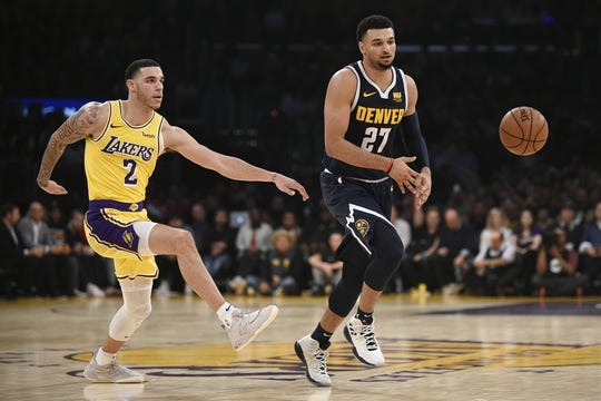 Oct 25, 2018; Los Angeles, CA, USA; Denver Nuggets guard Jamal Murray (27) passes the ball while Los Angeles Lakers guard Lonzo Ball (2) defends during the first half at Staples Center. Mandatory Credit: Kelvin Kuo-USA TODAY Sports