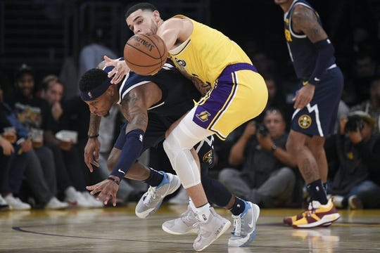 Oct 25, 2018; Los Angeles, CA, USA; Los Angeles Lakers guard Lonzo Ball (2) and Denver Nuggets forward Torrey Craig (3) battle for the ball during the first half at Staples Center. Mandatory Credit: Kelvin Kuo-USA TODAY Sports