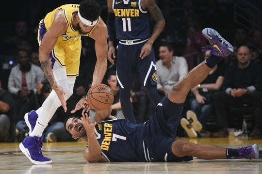 Oct 25, 2018; Los Angeles, CA, USA; Denver Nuggets forward Trey Lyles (7) and Los Angeles Lakers center JaVale McGee (7) battle for the ball during the first half at Staples Center. Mandatory Credit: Kelvin Kuo-USA TODAY Sports