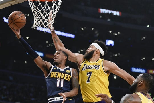 Oct 25, 2018; Los Angeles, CA, USA; Denver Nuggets guard Monte Morris (11) attempts a shot past Los Angeles Lakers center JaVale McGee (7) during the first half at Staples Center. Mandatory Credit: Kelvin Kuo-USA TODAY Sports