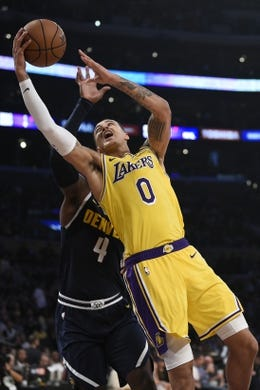 Oct 25, 2018; Los Angeles, CA, USA; Los Angeles Lakers forward Kyle Kuzma (0) goes up for a shot past Denver Nuggets forward Paul Millsap (4) during the second half at Staples Center. Mandatory Credit: Kelvin Kuo-USA TODAY Sports