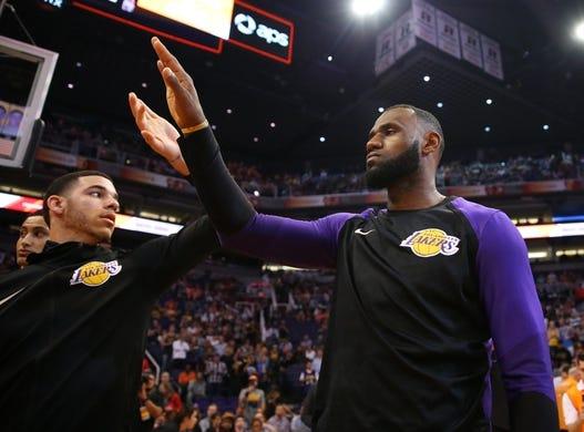 Oct 24, 2018; Phoenix, AZ, USA; Los Angeles Lakers forward Lebron James (right) greets teammate Lonzo Ball against the Phoenix Suns at Talking Stick Resort Arena. Mandatory Credit: Mark J. Rebilas-USA TODAY Sports