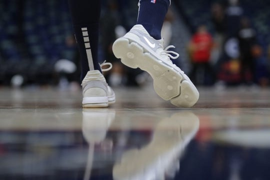 Oct 26, 2018; New Orleans, LA, USA; A detail of shoes worn by New Orleans Pelicans forward Nikola Mirotic (3) as he warms up before the game against the Brooklyn Nets at Smoothie King Center. Mandatory Credit: Stephen Lew-USA TODAY Sports