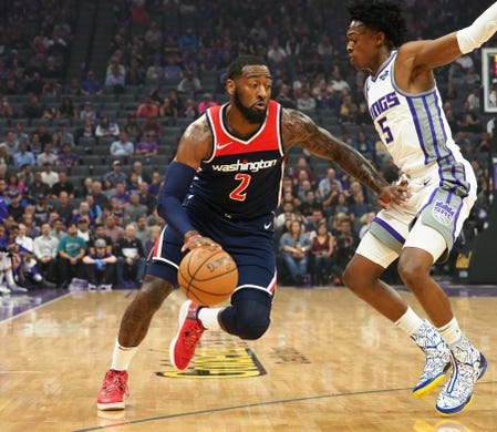Oct 26, 2018; Sacramento, CA, USA; Washington Wizards guard John Wall (2) drives in against Sacramento Kings guard De'Aaron Fox (5) during the first quarter at Golden 1 Center. Mandatory Credit: Kelley L Cox-USA TODAY Sports