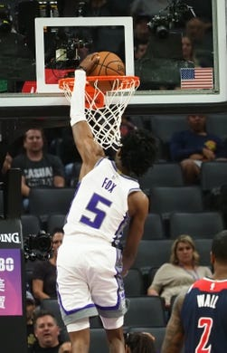 Oct 26, 2018; Sacramento, CA, USA; Sacramento Kings guard De'Aaron Fox (5) dunks the ball against the Washington Wizards during the second quarter at Golden 1 Center. Mandatory Credit: Kelley L Cox-USA TODAY Sports