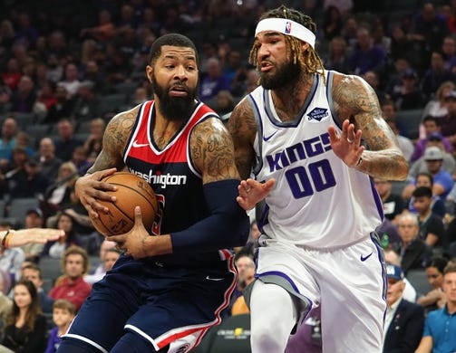 Oct 26, 2018; Sacramento, CA, USA; Washington Wizards forward Markieff Morris (5) drives in against Sacramento Kings center Willie Cauley-Stein (00) during the first quarter at Golden 1 Center. Mandatory Credit: Kelley L Cox-USA TODAY Sports