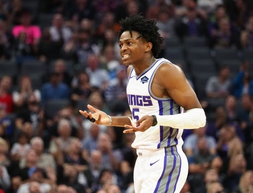 Oct 26, 2018; Sacramento, CA, USA; Sacramento Kings guard De'Aaron Fox (5) reacts after being called for a foul against the Washington Wizards during the second quarter at Golden 1 Center. Mandatory Credit: Kelley L Cox-USA TODAY Sports