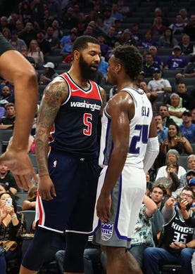 Oct 26, 2018; Sacramento, CA, USA; Washington Wizards forward Markieff Morris (5) has words with Sacramento Kings guard Buddy Hield (24) before being issued a technical during the second quarter at Golden 1 Center. Mandatory Credit: Kelley L Cox-USA TODAY Sports