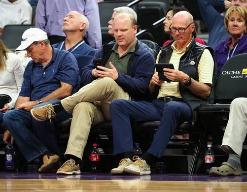 Oct 26, 2018; Sacramento, CA, USA; Courtside fans on their mobile device during the third quarter between the Sacramento Kings and the Washington Wizards at Golden 1 Center. Mandatory Credit: Kelley L Cox-USA TODAY Sports