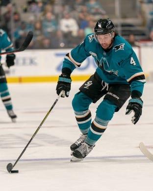 Oct 20, 2018; San Jose, CA, USA; San Jose Sharks defenseman Brenden Dillon (4) controls the puck against the New York Islanders during the second period at SAP Center at San Jose. Mandatory Credit: Neville E. Guard-USA TODAY Sports