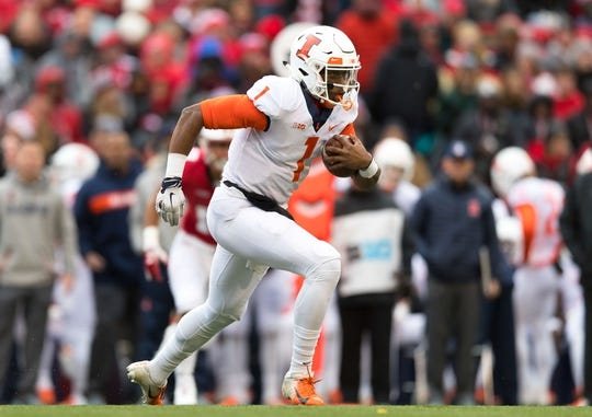 Oct 20, 2018; Madison, WI, USA; Illinois Fighting Illini quarterback AJ Bush Jr. (1) during the game against the Wisconsin Badgers at Camp Randall Stadium. Mandatory Credit: Jeff Hanisch-USA TODAY Sports