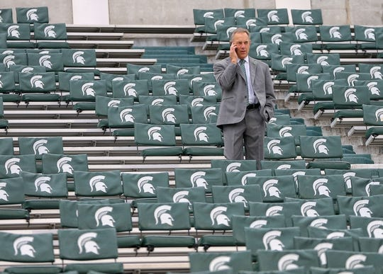 Oct 27, 2018; East Lansing, MI, USA; Michigan State Spartans head coach Mark Dantonio makes a call from stands prior to a game against the Purdue Boilermakers at Spartan Stadium. Mandatory Credit: Mike Carter-USA TODAY Sports