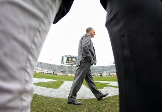 Oct 27, 2018; East Lansing, MI, USA; Michigan State Spartans head coach Mark Dantonio stands on field prior to the team walking the field prior to a game at Spartan Stadium. Mandatory Credit: Mike Carter-USA TODAY Sports