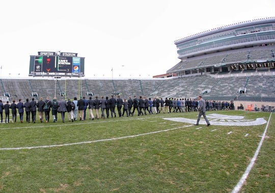 Oct 27, 2018; East Lansing, MI, USA; Michigan State Spartans head coach Mark Dantonio walks the field with his team prior to a game against the Purdue Boilermakers at Spartan Stadium. Mandatory Credit: Mike Carter-USA TODAY Sports