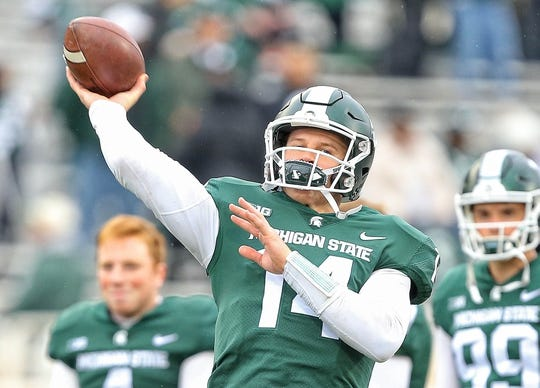 Oct 27, 2018; East Lansing, MI, USA; Michigan State Spartans quarterback Brian Lewerke (14) warms up prior to a game against the Purdue Boilermakers at Spartan Stadium. Mandatory Credit: Mike Carter-USA TODAY Sports