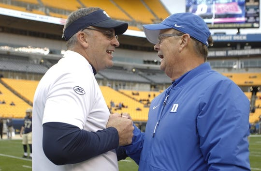 Oct 27, 2018; Pittsburgh, PA, USA;  Pittsburgh Panthers head coach Pat Narduzzi (left) and Duke Blue Devils head coach David Cutcliffe (right) shake hands before their teams play at Heinz Field. Mandatory Credit: Charles LeClaire-USA TODAY Sports