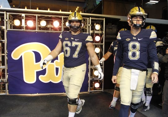 Oct 27, 2018; Pittsburgh, PA, USA;  Pittsburgh Panthers center Jimmy Morrissey (67) and quarterback Kenny Pickett (8) take the field for warm-ups before a game against the Duke Blue Devils at Heinz Field. Mandatory Credit: Charles LeClaire-USA TODAY Sports