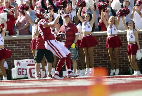 Oct 27, 2018; Norman, OK, USA; Oklahoma Sooners tight end Grant Calcaterra (80) reacts after catching a touchdown pass during the first quarter against the Kansas State Wildcats at Gaylord Family - Oklahoma Memorial Stadium. Mandatory Credit: Kevin Jairaj-USA TODAY Sports