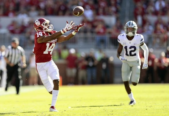 Oct 27, 2018; Norman, OK, USA; Oklahoma Sooners wide receiver Charleston Rambo (14) drops a pass as Kansas State Wildcats defensive back AJ Parker (12) defends during the first quarter at Gaylord Family - Oklahoma Memorial Stadium. Mandatory Credit: Kevin Jairaj-USA TODAY Sports