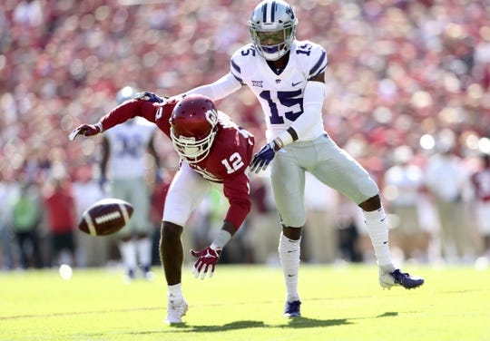 Oct 27, 2018; Norman, OK, USA; Oklahoma Sooners wide receiver A.D. Miller (12) is interfered with by Kansas State Wildcats defensive back Walter Neil Jr. (15) during the first quarter at Gaylord Family - Oklahoma Memorial Stadium. Mandatory Credit: Kevin Jairaj-USA TODAY Sports