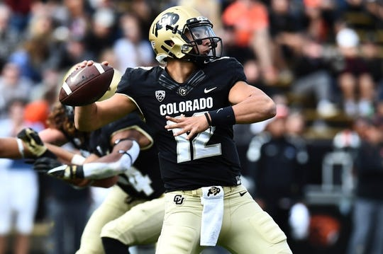 Oct 27, 2018; Boulder, CO, USA; Colorado Buffaloes quarterback Steven Montez (12) prepares to pass the ball in the second quarter against the Oregon State Beavers at Folsom Field. Mandatory Credit: Ron Chenoy-USA TODAY Sports