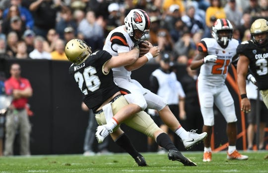 Oct 27, 2018; Boulder, CO, USA; Colorado Buffaloes linebacker Carson Wells (26) sacks Oregon State Beavers quarterback Jack Colletto (12) in the first quarter at Folsom Field. Mandatory Credit: Ron Chenoy-USA TODAY Sports