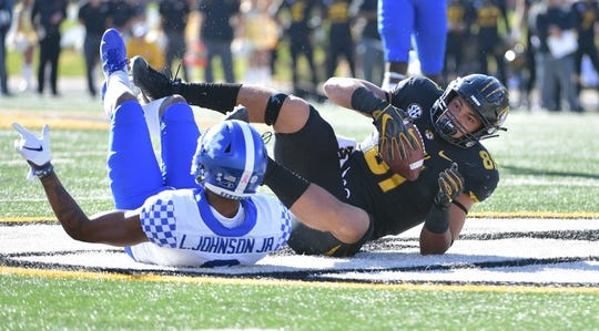 Oct 27, 2018; Columbia, MO, USA; Missouri Tigers tight end Albert Okwuegbunam (81) catches a pass and is tackled by Kentucky Wildcats cornerback Derrick Baity Jr. (8) during the first half at Memorial Stadium/Faurot Field. Mandatory Credit: Denny Medley-USA TODAY Sports
