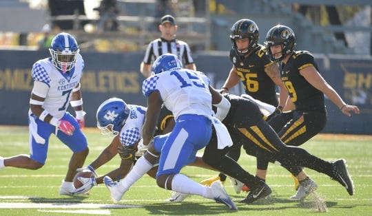 Oct 27, 2018; Columbia, MO, USA; Kentucky Wildcats cornerback Derrick Baity Jr. (8) recovers a blocked punt during the first half against the Missouri Tigers at Memorial Stadium/Faurot Field. Mandatory Credit: Denny Medley-USA TODAY Sports