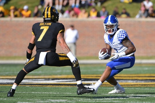 Oct 27, 2018; Columbia, MO, USA; Kentucky Wildcats wide receiver Lynn Bowden Jr. (1) runs the ball as Missouri Tigers safety Cam Hilton (7) defends during the first half at Memorial Stadium/Faurot Field. Mandatory Credit: Denny Medley-USA TODAY Sports