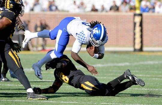 Oct 27, 2018; Columbia, MO, USA; Kentucky Wildcats quarterback Terry Wilson (3) runs the ball and is tackled by Missouri Tigers safety Joshuah Bledsoe (18) during the first half at Memorial Stadium/Faurot Field. Mandatory Credit: Denny Medley-USA TODAY Sports