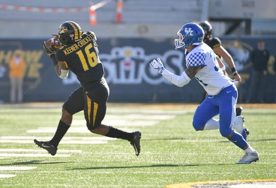 Oct 27, 2018; Columbia, MO, USA; Missouri Tigers running back Damarea Crockett (16) caches a pass as Kentucky Wildcats linebacker Jordan Jones (34) chases during the first half at Memorial Stadium/Faurot Field. Mandatory Credit: Denny Medley-USA TODAY Sports