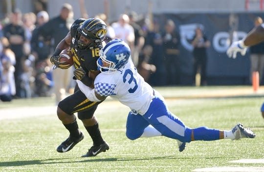 Oct 27, 2018; Columbia, MO, USA; Missouri Tigers running back Damarea Crockett (16) caches a pass and is tackled by Kentucky Wildcats linebacker Jordan Jones (34) during the first half at Memorial Stadium/Faurot Field. Mandatory Credit: Denny Medley-USA TODAY Sports