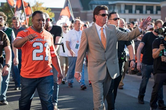 Oct 27, 2018; Stillwater, OK, USA; Barry Sanders (left) and Oklahoma State Cowboys head coach Mike Gundy (right) before the game against the Texas Longhorns at Boone Pickens Stadium. Mandatory Credit: Rob Ferguson-USA TODAY Sports