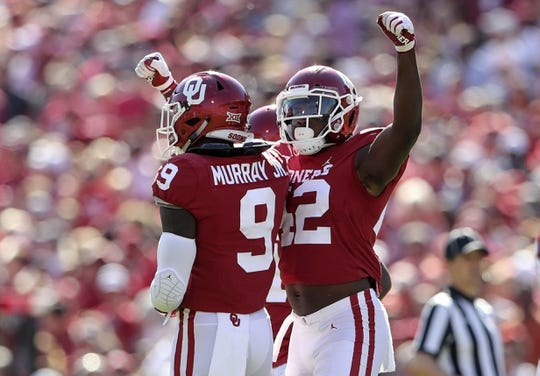 Oct 27, 2018; Norman, OK, USA; Oklahoma Sooners defensive end Mark Jackson Jr. (42) and  linebacker Kenneth Murray (9) react during the first half against the Kansas State Wildcats at Gaylord Family - Oklahoma Memorial Stadium. Mandatory Credit: Kevin Jairaj-USA TODAY Sports