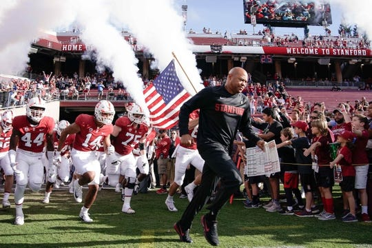 Oct 27, 2018; Stanford, CA, USA; Stanford Cardinal head coach David Shaw runs out with his team before a game against the Washington State Cougars at Stanford Stadium. Mandatory Credit: Stan Szeto-USA TODAY Sports