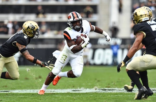 Oct 27, 2018; Boulder, CO, USA; Oregon State Beavers running back Jermar Jefferson (22) carries past Colorado Buffaloes defensive back Trey Udoffia (8) in the second quarter at Folsom Field. Mandatory Credit: Ron Chenoy-USA TODAY Sports