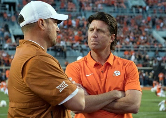 Oct 27, 2018; Stillwater, OK, USA; Texas Longhorns head coach Tom Herman (left) and Oklahoma State Cowboys head coach Mike Gundy (right) talk before the game at Boone Pickens Stadium. Mandatory Credit: Rob Ferguson-USA TODAY Sports