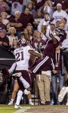 Oct 27, 2018; Starkville, MS, USA; Mississippi State Bulldogs wide receiver Stephen Guidry (1) makes a leaping touchdown catch against Texas A&M Aggies defensive back Charles Oliver (21) trailing during the first half at Davis Wade Stadium. Mandatory Credit: Vasha Hunt-USA TODAY Sports