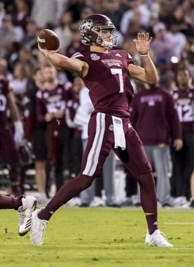 Oct 27, 2018; Starkville, MS, USA; Mississippi State Bulldogs quarterback Nick Fitzgerald (7) throws a 25-yard touchdown to wide receiver Stephen Guidry (not pictured) against the Texas A&M Aggies during the first half at Davis Wade Stadium. Mandatory Credit: Vasha Hunt-USA TODAY Sports