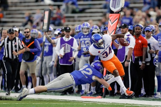 Oct 27, 2018; Colorado Springs, CO, USA; Air Force Falcons linebacker Blake Dailey (42) pushes Boise State Broncos running back Robert Mahone (34) out of bounds in the first quarter at Falcon Stadium. Mandatory Credit: Isaiah J. Downing-USA TODAY Sports