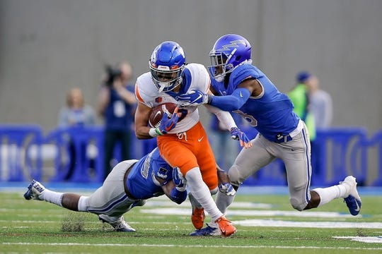 Oct 27, 2018; Colorado Springs, CO, USA; Boise State Broncos wide receiver Sean Modster (8) is tackled by Air Force Falcons linebacker Kyle Floyd (29) and defensive back Zane Lewis (6) in the first quarter a at Falcon Stadium. Mandatory Credit: Isaiah J. Downing-USA TODAY Sports