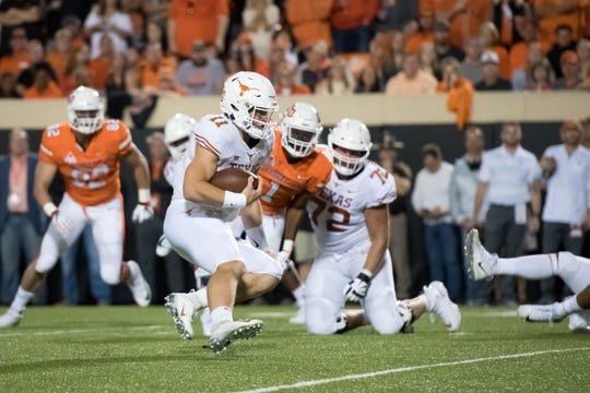 Oct 27, 2018; Stillwater, OK, USA; Texas Longhorns quarterback Sam Ehlinger (11) runs the ball against the Oklahoma State Cowboys during the first quarter at Boone Pickens Stadium. Mandatory Credit: Rob Ferguson-USA TODAY Sports
