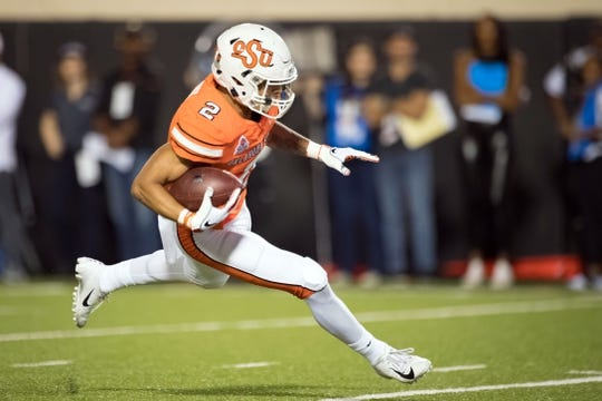Oct 27, 2018; Stillwater, OK, USA; Oklahoma State Cowboys wide receiver Tylan Wallace (2) runs the ball for a touchdown against the Texas Longhorns during the first quarter at Boone Pickens Stadium. Mandatory Credit: Rob Ferguson-USA TODAY Sports