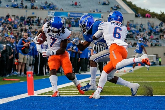 Oct 27, 2018; Colorado Springs, CO, USA; Boise State Broncos wide receiver A.J. Richardson (7) scores a touchdown behind Broncos wide receiver CT Thomas (6) and Air Force Falcons defensive back Zane Lewis (6) in the second quarter at Falcon Stadium. Mandatory Credit: Isaiah J. Downing-USA TODAY Sports