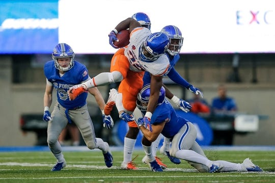 Oct 27, 2018; Colorado Springs, CO, USA; Boise State Broncos running back Alexander Mattison (22) is tackled by Air Force Falcons defensive back Jeremy Fejedelem (2) in the second quarter at Falcon Stadium. Mandatory Credit: Isaiah J. Downing-USA TODAY Sports