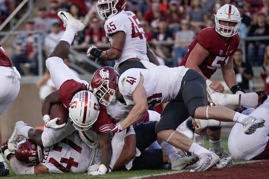 Oct 27, 2018; Stanford, CA, USA; Washington State Cougars linebacker Dillon Sherman (41) tackles Stanford Cardinal running back Trevor Speights (23) during the second quarter at Stanford Stadium. Mandatory Credit: Stan Szeto-USA TODAY Sports